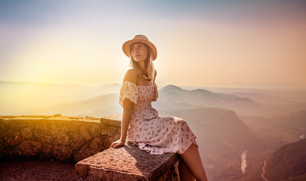 carefree female relaxing on top of the mountains