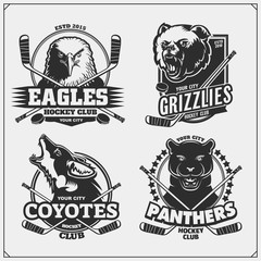 Set of hockey badges, labels and design elements. Sport club emblems with grizzly bear, panther, coyote and eagle. Print design for t-shirts.