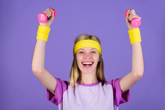 Vintage sport concept. Woman exercising with dumbbells. Easy exercises with dumbbells. Workout with dumbbells. Ultimate upper body workout for women. Girl hold dumbbells wear bright wristbands