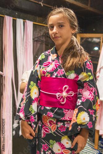 5f12b2b782d0d A pretty girl in a kimono. Kimono is the traditional dress worn ...