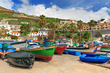 Beautiful view of the colored fisher boats in the Harbor of Camara de Lobos on the island of Madeira in summer