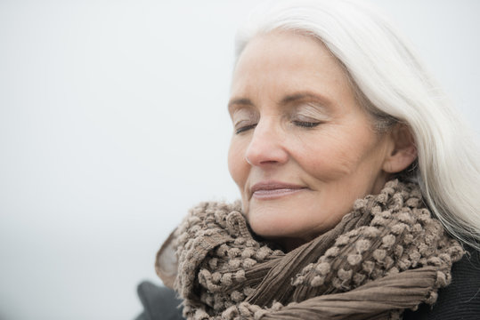 mature woman with grey hair dreaming