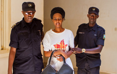 Diane Shima Rwigara, a prominent critic of Rwanda's president Paul Kagame, is escorted by policemen into a courtroom in Kigali