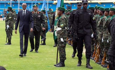 Rwanda's President-elect Paul Kagame inspects the guard of honour before his swearing-in ceremony at Amahoro stadium in Kigali