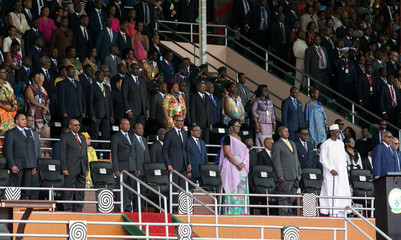 Rwanda's President-elect Paul Kagame is flanked by other African leaders and his wife Jeannette during his swearing-in ceremony at Amahoro stadium in Kigali