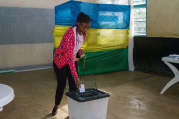 A voter casts her ballot at a polling station in Kigali