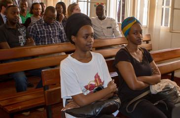 Diane Shima Rwigara, a prominent critic of Rwanda's president Paul Kagame, sits alongside her sister Anne Rwigara inside the courtroom in Kigali