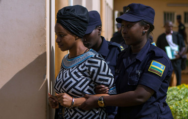 Sister of Kagame critic Diane Shiman Rwigara is escorted by police in Kigali