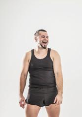 portrait of charismatic trainer on bodybuilding on a light backg