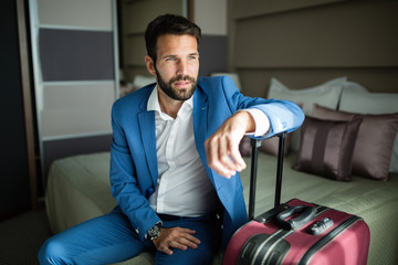 Portrait of handsome businessman in hotel room