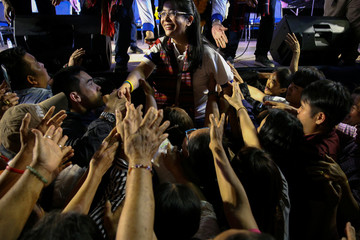 Sudarat Keyuraphan, Pheu Thai Party's Prime Minister candidate, greets her supporters during an election campaign in Ubon Ratchathani Province
