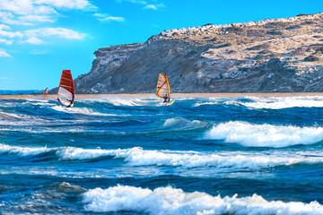 Two windsurfers surfing on Prasonisi beach (Rhodes, Greece)