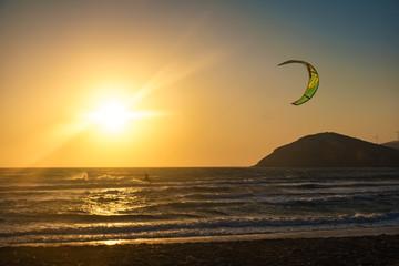 Sunset on Prasonisi beach with kitesurfer (Rhodes, Greece)