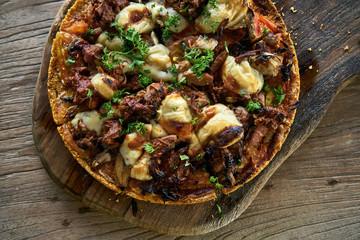 Cooked Jackfruit vegetarian pizza on wooden board