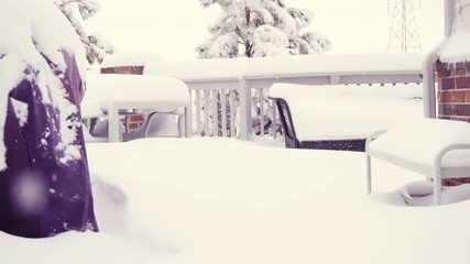 Wall Mural - Slow motion. Outdoor gas grill covered with snow on back porch.