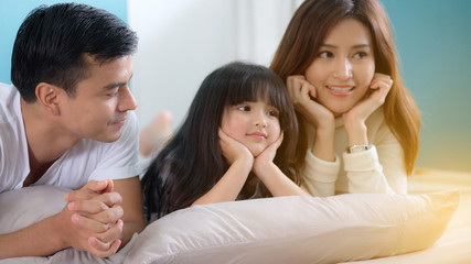 The beautiful family in living room, Father with mother and daughter having fun together with smile.
