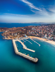 Amazing day aerial view.  Seascape of the rocks at the coastline of Chernomorets, Burgas region, Bulgaria. The beautiful beach of the black sea captured by the air in the summer.