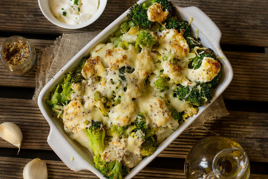 Baked gratin of cauliflower, broccoli and romanesco with cream and mustard sauce