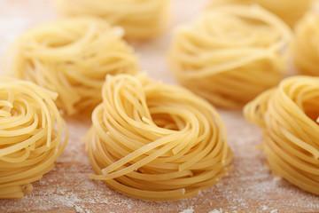 Uncooked italian egg pasta nests