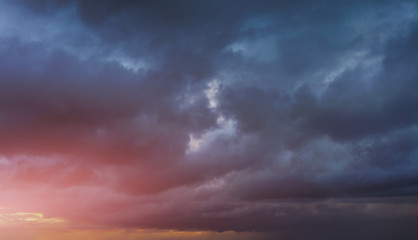 background of cloudy dark sky at sunset