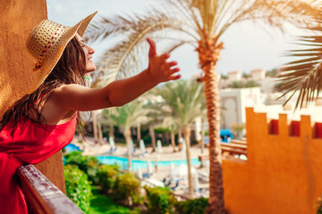 Fototapeta Young woman enjoying the view from hotel balcony in Egypt. Having good time in tropical resort