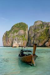 Longtail boat anchored at Maya Bay on Phi Phi Leh Island, Krabi Province, Thailand