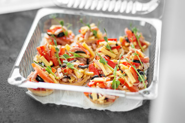 Delicious snacks with meat and vegetables in lunch box. Concept of food, restaurant, catering, menu.