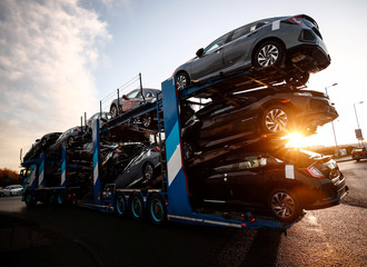 A lorry with car carrier trailer leaves the Honda car plant in Swindon