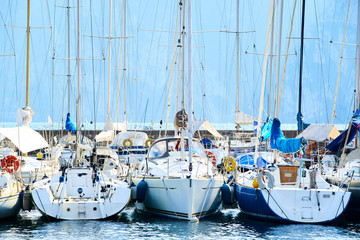 Sailboat harbor, Close up of many beautiful moored sail yachts and boats in the sea port, modern water transport, summertime vacation