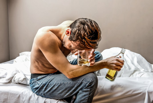Lonely man is addicted of alcohol. He rolls down in addiction.