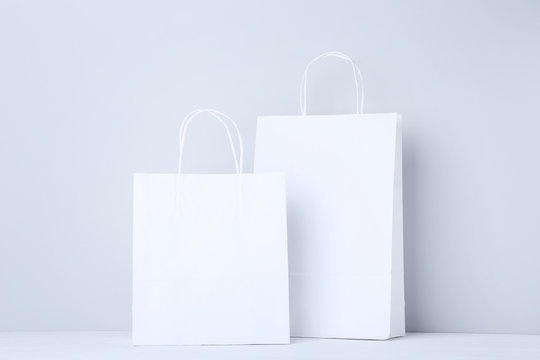 White shopping bags on grey background