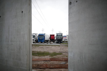 Three meters high concrete blocks put up to build a wall around a Total gas station to prevent migrants from trying to board on trucks are pictured in Calais
