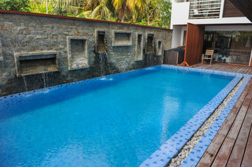 Swimming pool of hotel.Beautiful luxury outdoor swimming pool with stair in hotel and resort for holiday travel and vacation