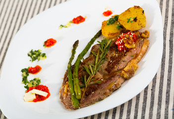 Image of veal with baked vegetables