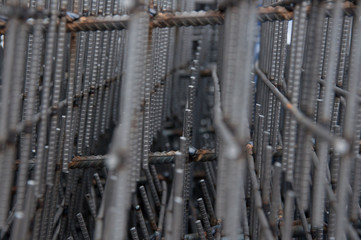 Billets of reinforcement at the construction site. Construction of the building with the help of reinforced concrete. Reinforcement of concrete base.