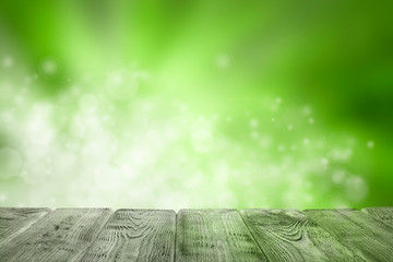 Wooden table of free space and green abstract background