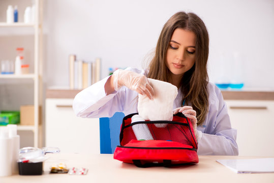 Female beautiful doctor with first aid bag