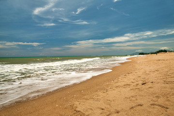 Beautiful view of the deserted beach, the sea and the blue sky on the island of Hainan.