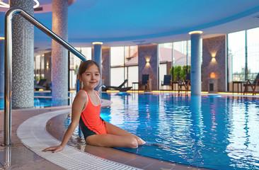 girl playing in the big pool