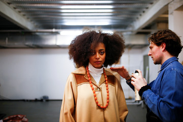 A model prepares backstage of the 'Oxfam Fashion Fighting Poverty' catwalk at London Fashion Week Women's A/W19 in London