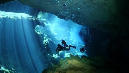Wall Mural - scuba diver exploring a cave