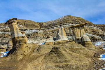 Hoodoos show the wear and tear from erosion and rain in the badlands, Drumheller, Alberta, Canada