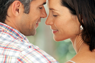 moment of intimacy between middle aged man and woman