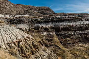 Scars in the ground, multi coloured rings and red rocks mean your in the Badlands, Drumheller, Alberta, Canada