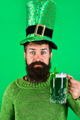 Saint Patrick's Day. Saint Patrick's Day symbols. Bearded man in green top hat holds glass with beer. Green beer. Patricks Day green shamrock. Ireland tradition. Pub.