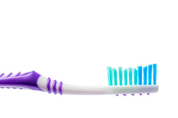colored toothbrush on an isolated background, close up