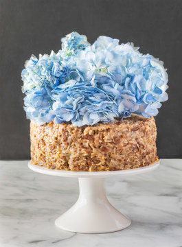 Gourmet German chocolate cake with flower decorations.