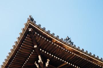 Japanese traditional roof background at Honko-ji Temple, Amagasaki Teramachi street in Hyogo, Japan