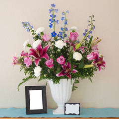 Pretty Pink and Lavender Flower Bouquet in White Vase.  Square crop