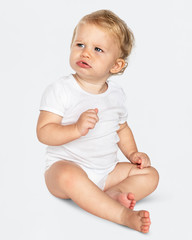 Baby sitting on the floor in a studio